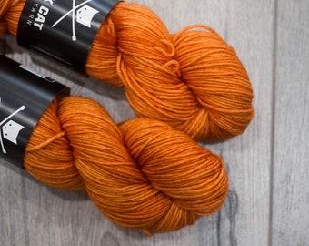 DK weight merino yarn 100% Superwash Merino Sweater weight yarn. Double Knit Weight yarn. Legendary Orange. Semi-Solid orange yarn. Tonal