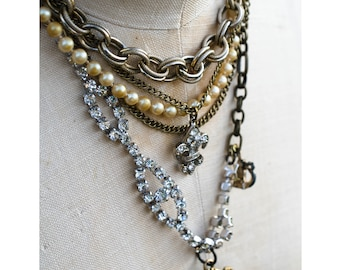 a JUXTAPOSITION of pearls, rhinestones and antiqued chain - a vintage assemblage necklace with gritty femininity!