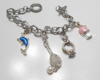 Vintage Souvenir Charm Bracelet (2515) Cupcake, Engagement Ring, Tennis Racket & Ball, And Dolphin