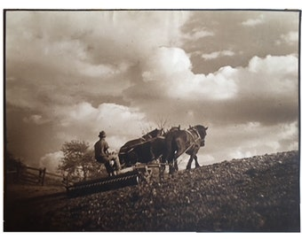 Early bichromate sepia print of farmer and horses plowing