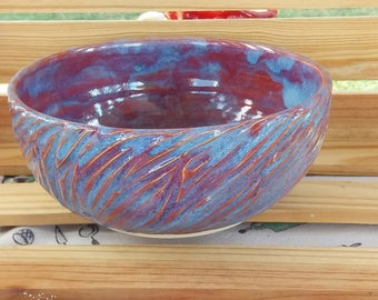 Medium blue and purple bowl with carvings