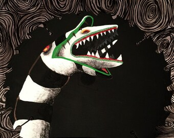 Sandworm from Beetlejuice painting on a circular saw blade
