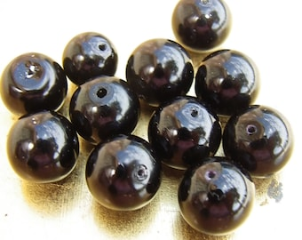15 beautiful black 14 mm without being mother of Pearl round beads