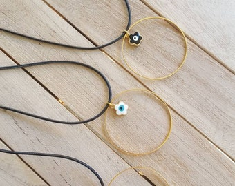 Necklace with a gold plated ring pendant and an evil eye flower charm