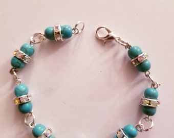 Teal and jeweled silver beaded bracelet