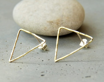 Earrings are made of thin hammered brass triangle studs