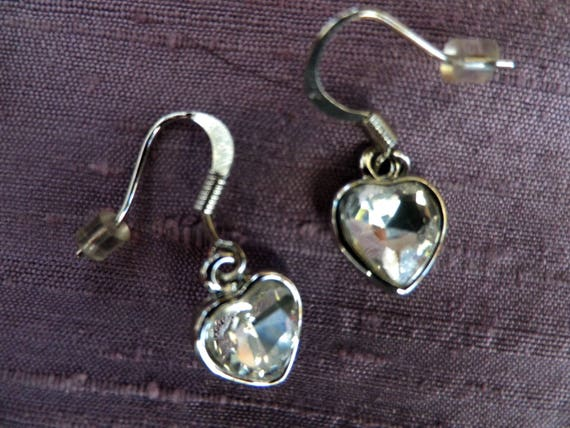 Heart shaped silver tone drop earrings with clear glass paste stones