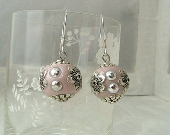 Pink earrings with ceramic beads