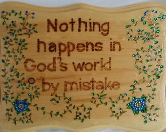 Nothing happens in Gods world by mistake wood burned, painted and embellished with colored crystals blue flowers