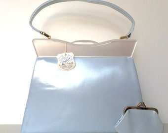 Vintage 50s/60s pearlescent 'Arctic blue' leather/white lucite unused Kelly top handle bag with matching coin purse made in England by Lodix