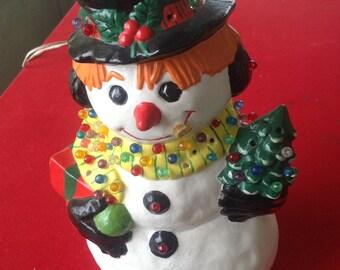 Handmade ceramic lighted snowman
