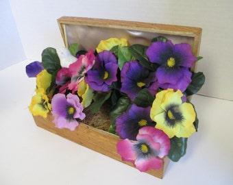 Flower arrangement in a wooden Jewelery box .
