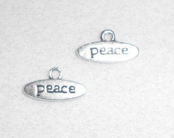 "Silver ""Peace"" saying Charms"