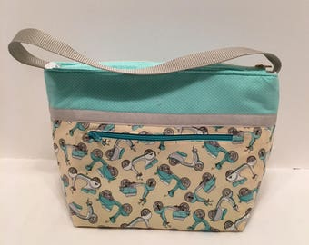 "LIPL15- Deep Lunch Bag: ""Scooting Along"" washable insulated lunch bag with zippered front pocket and zippered top closure."