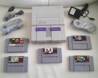 Super Nintendo SnesComplete console system with 2 new controllers still sealed & 5 games