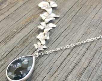 Black with five orchid stone and rhodium plated silver plated chain necklace