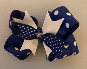 Blue and white polka dot hair bow