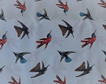 Birds on sky blue patterned printed viscose fabric