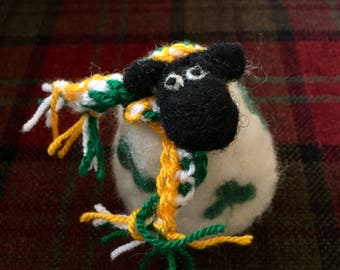 Saint Patrick's day sheep with green white and orange scarf