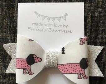 Pink sausage dog hair bow clip
