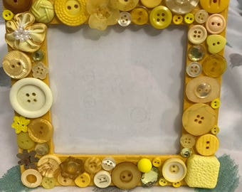 Yellow button adorned picture frame
