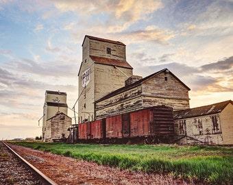 Old grain Elevator with train in rural alberta, Mossleigh Elevator
