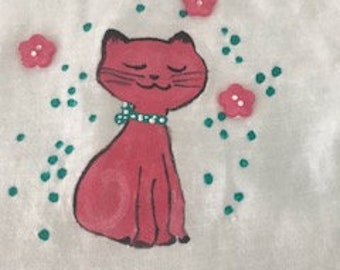 Pink Cat with green polka dot bow and pink pompoms