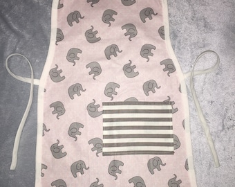Kids pink apron with gray elephants