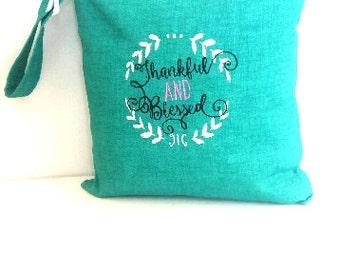 Turquoise waterproof bag, Embroidered wet bag, cloth diaper wet bag,  swimsuit bag, hanging wet bag, wet bathing suit bag, cloth diaper bag