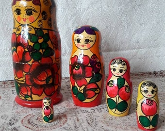 Traditional Russian wooden nesting dolls, a set of 5
