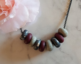 Dark and Stormy series perfect for winter. Gunmetal grey, maroon and gravel featured in this statement piece polymer neclace on 60cm.