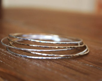 Five Hammered Silver and Gold Bangles Set