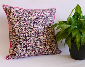 Peach african wax print cushion cover with pink pom pom trim