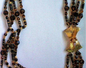 Hattie Carnegie Four Strand Glass Bead Necklace with Floral Clasp - 5789
