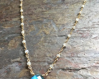 Moonstone gold necklace with a labradorite gemstone pendant