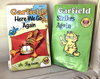 Two vintage Garfield comics 'Here we go again' 1989 and 'Strikes Back' 1985 by Jim Davis