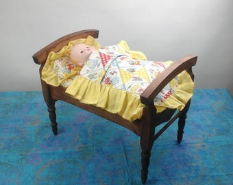Vintage doll bed, complete with pillow, Mattress and blanket, and porcelain doll.