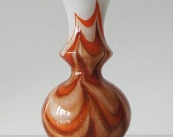 E.g Florence-aline Retro vase in the colours white, brown and orange circa 1960.