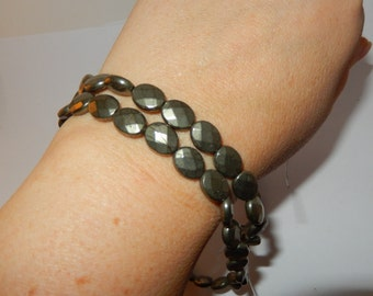"""Pyrite faceted oval beads - 16"""" strand"""