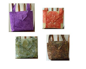 Small handbags in assorted fabric colors