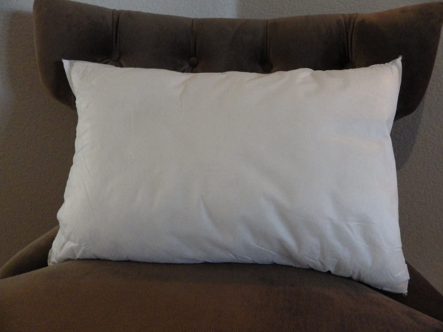 with white filled x feather insert covered cotton and down pillow square
