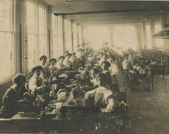 Women seamstresses working on sewing machines antique photo