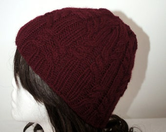 Lovely hand knitted cabled hat in wine red Aran wool by Liz