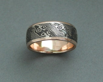 14kt palladium white gold with sterling silver Mokume-gane with 14 kt rose gold edges.