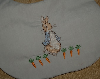 Beatrix Potter Peter Rabbit With Babies and Toddlers Cotton Soft Blue, White With Pink Trim, or White Bib Three layer Bib with a Poly Filler
