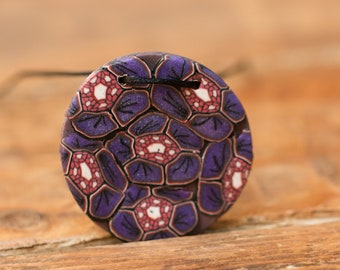 Polymer clay pendant patterned in shades of purple