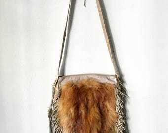 Red fox fur crossbody bags .