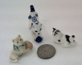C40  Three different cool cats. A tiny little set of three different cats. A unique set.