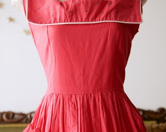 1940s pink cotton dress with large square collar, pockets and rhinestones.