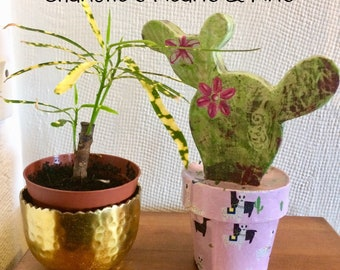 Decoupaged cactus with fun llama/cactus pot. Ideal display ornament with houseplants